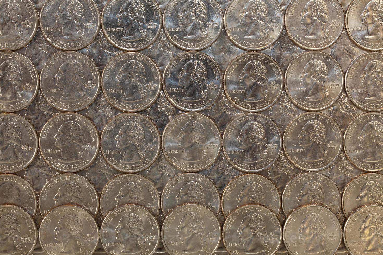 The same US coins on a glass table photo