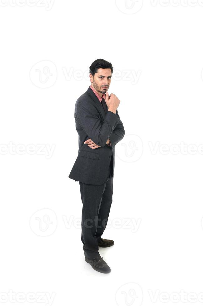 corporate portrait of young attractive businessman standing thoughtful photo