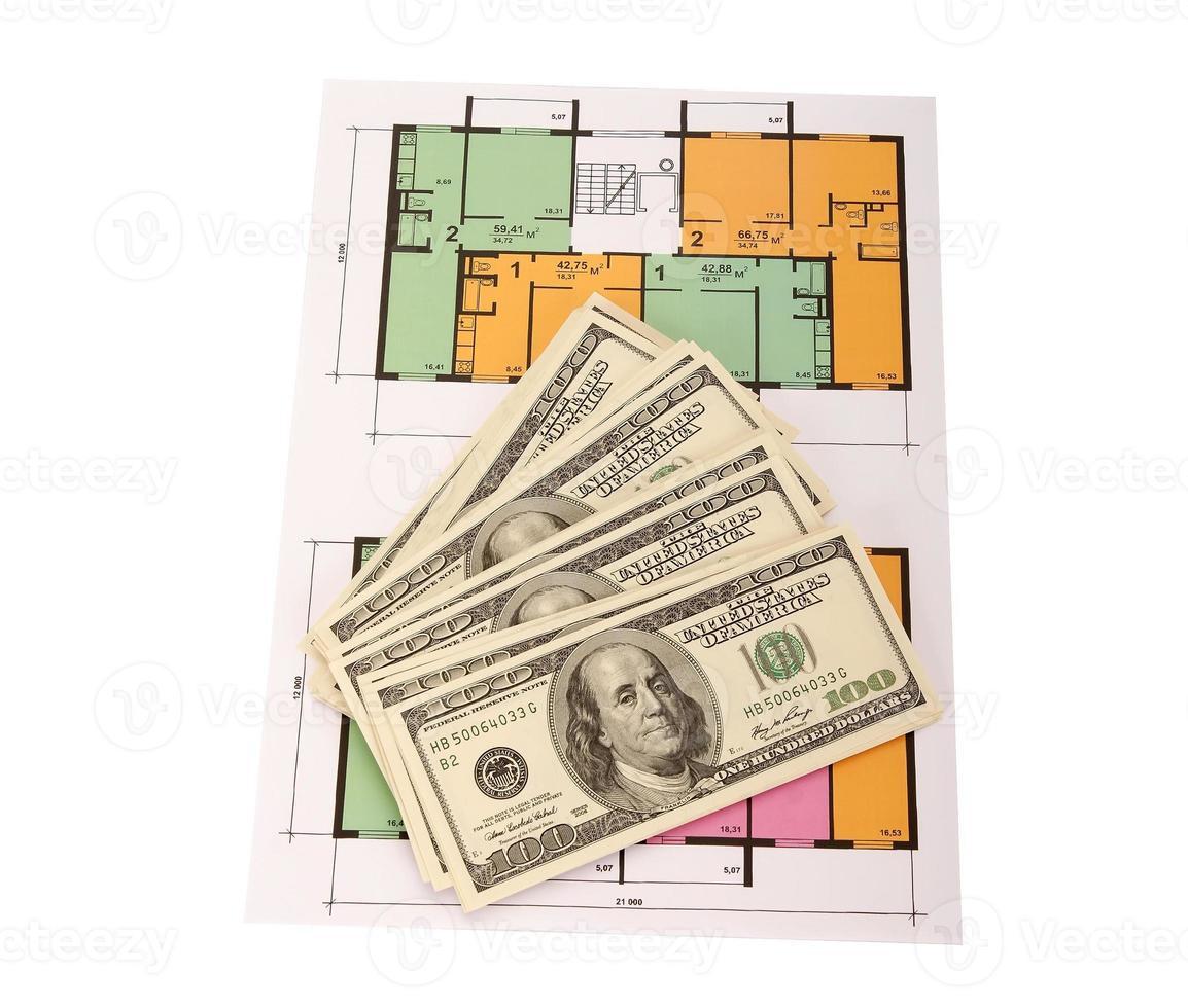 Hundred dollar bills money pile on blueprints photo