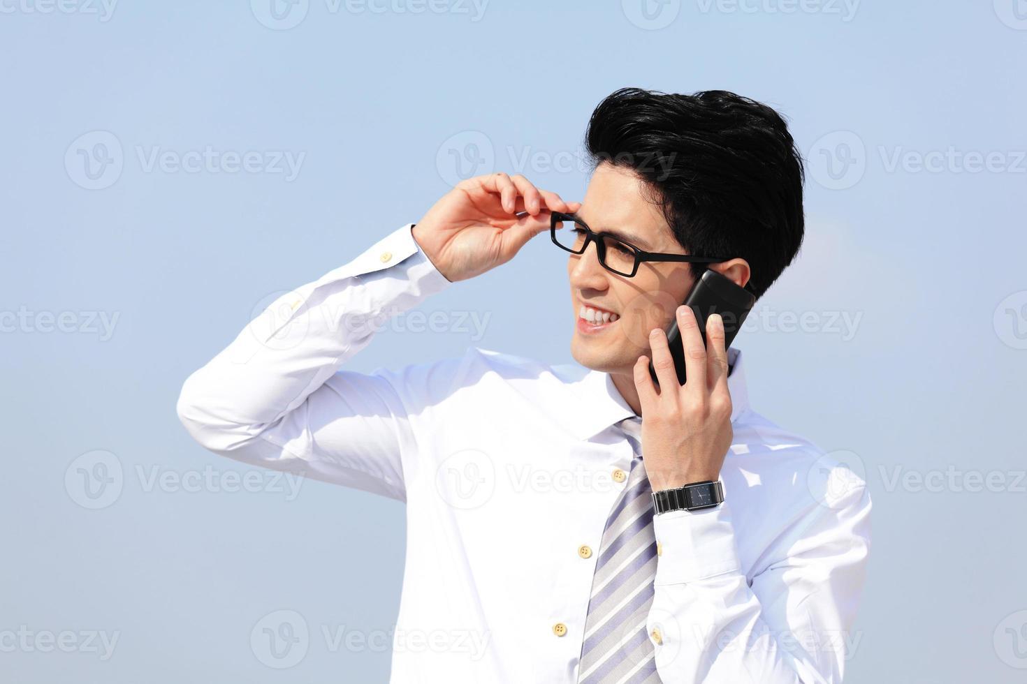 Business man talking on smart phone photo