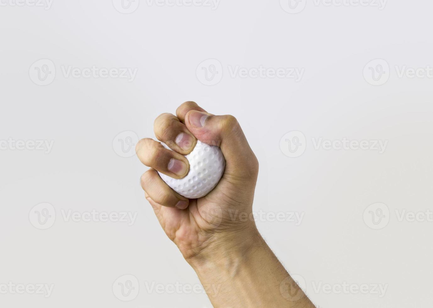 mano apretando la bola de estrés foto