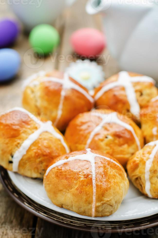 Easter buns with a cross and eggs photo
