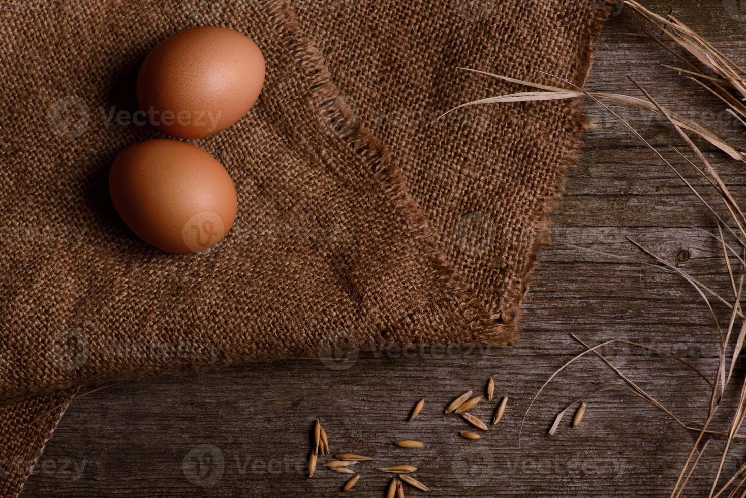 chicken eggs on burlap rustic background photo