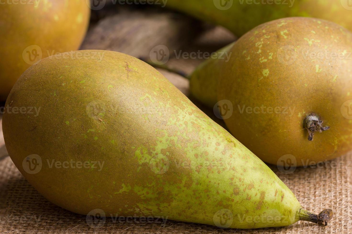 several pears conference on brown linen background - closeup photo