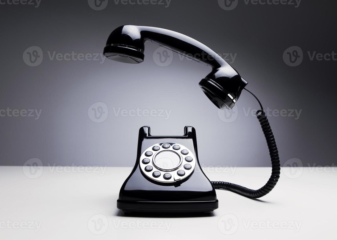 Vintage telephone over dark background photo