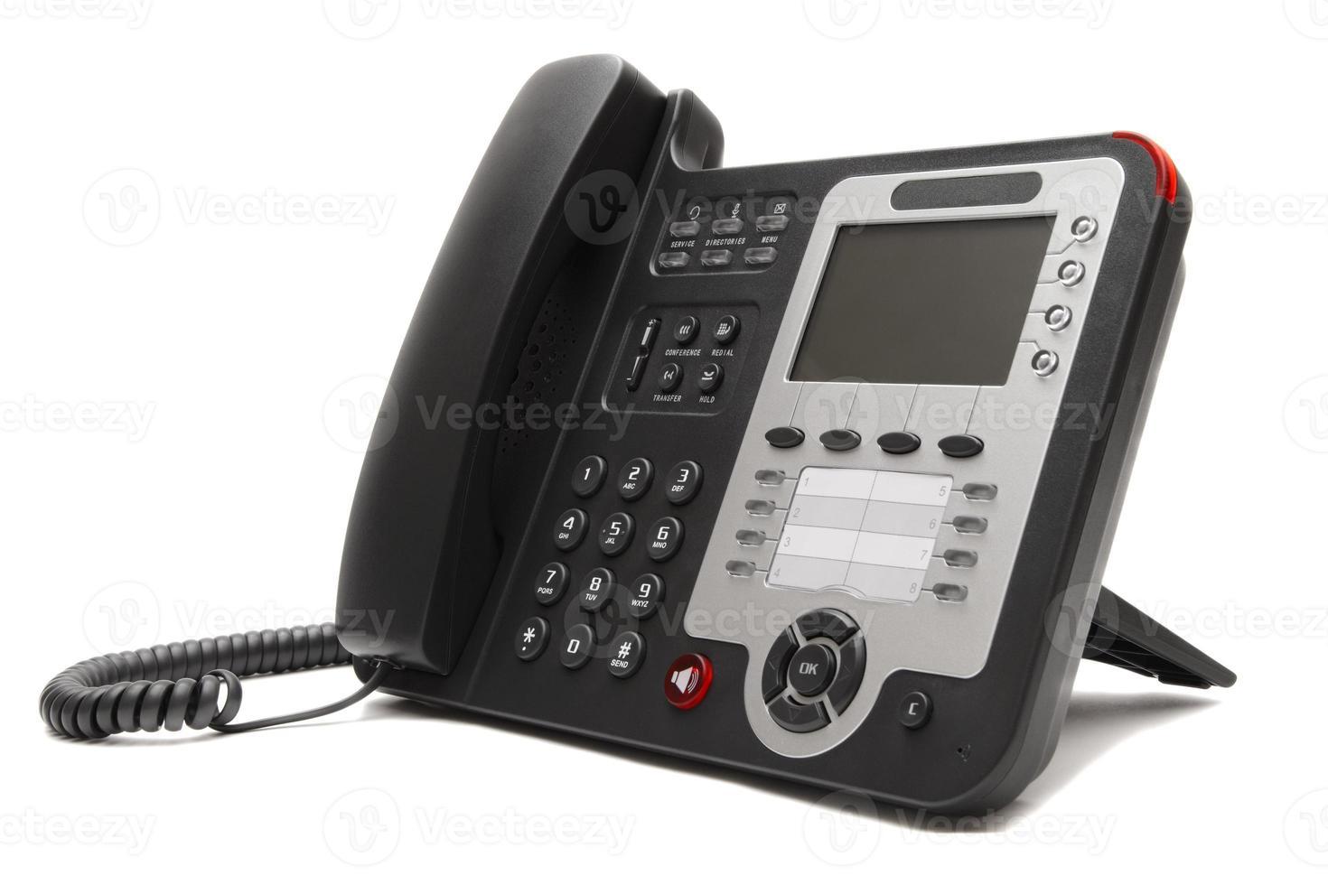 Black IP office phone isolated on white background photo