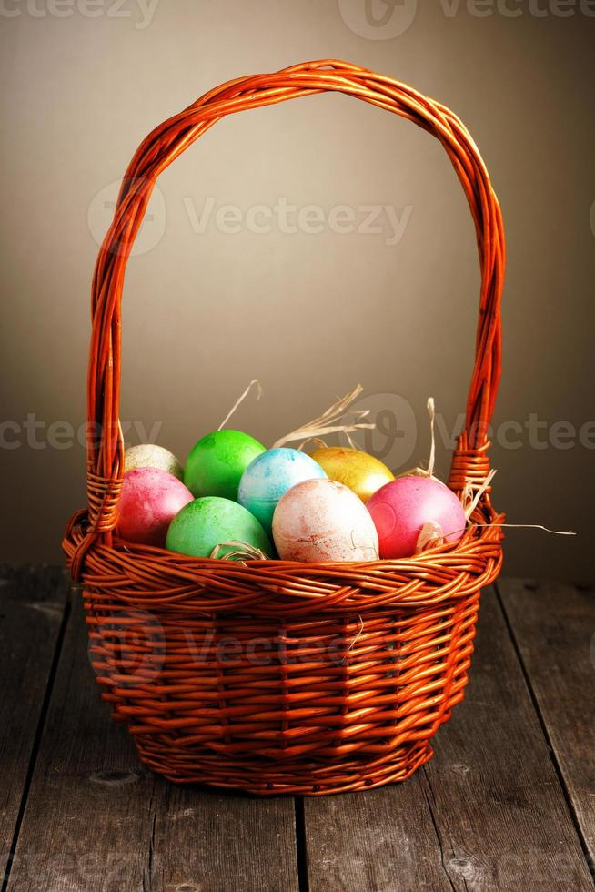Colored easter eggs in basket photo