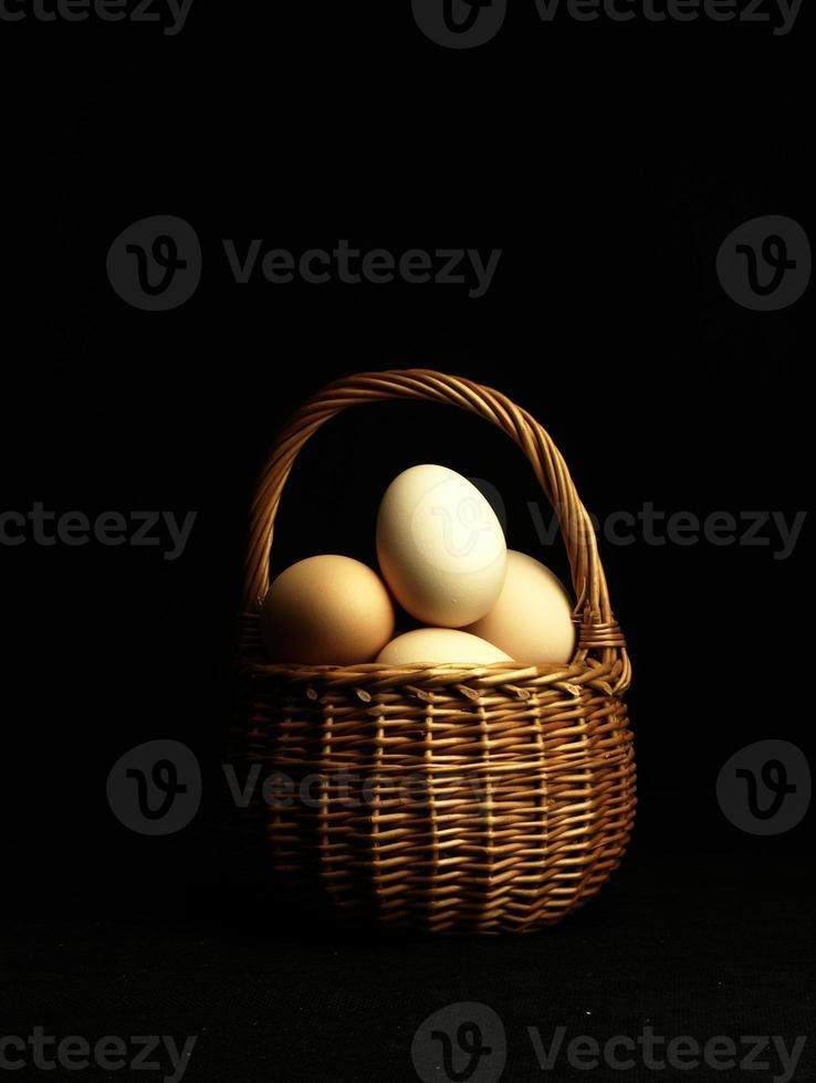 Easter eggs in a wicker basket. photo