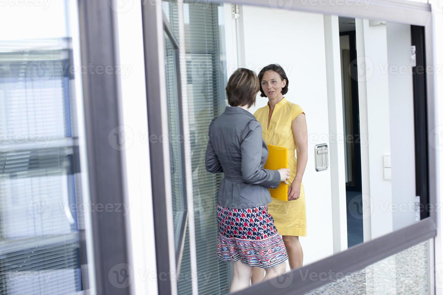 Businesswomen talking in office photo