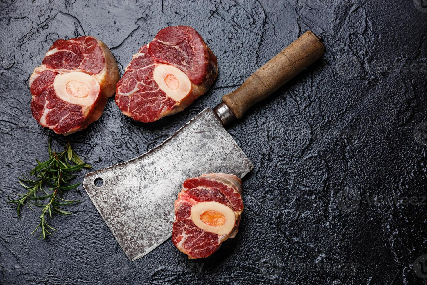 Raw cross cut veal shank for making Osso Buco photo