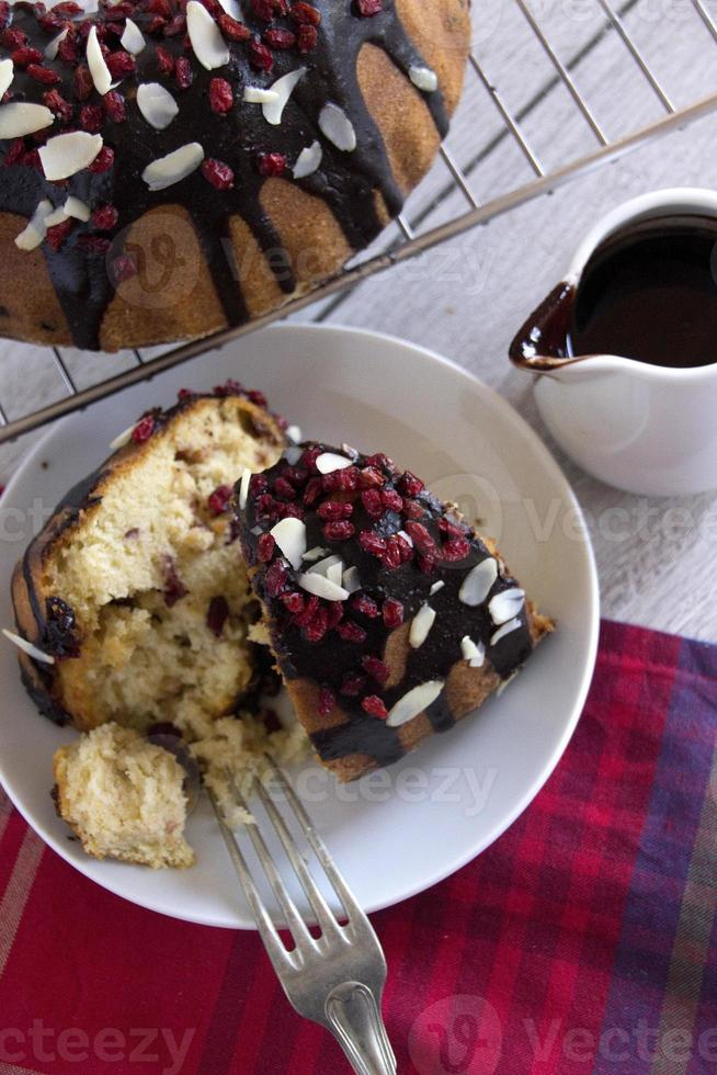 Slices of Cake With Chocolate Sauce, Cranberry  and Flaked Almonds photo
