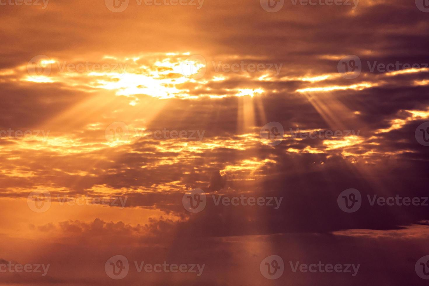 sunset sky with light rays photo