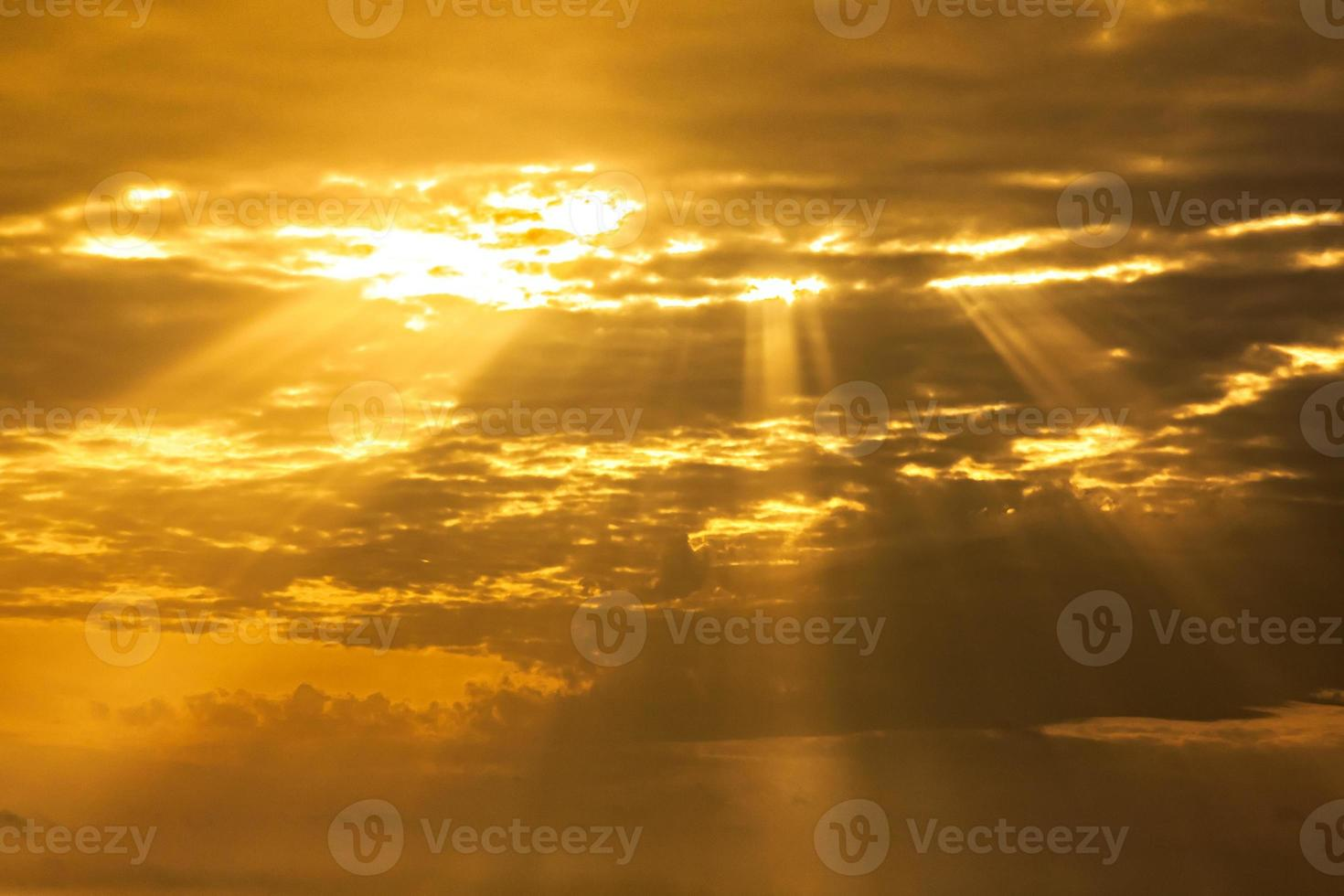 sunset sky with light rays photo