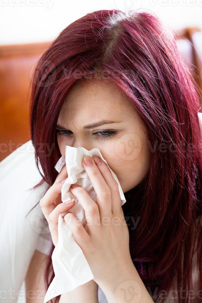 Woman blowing nose photo