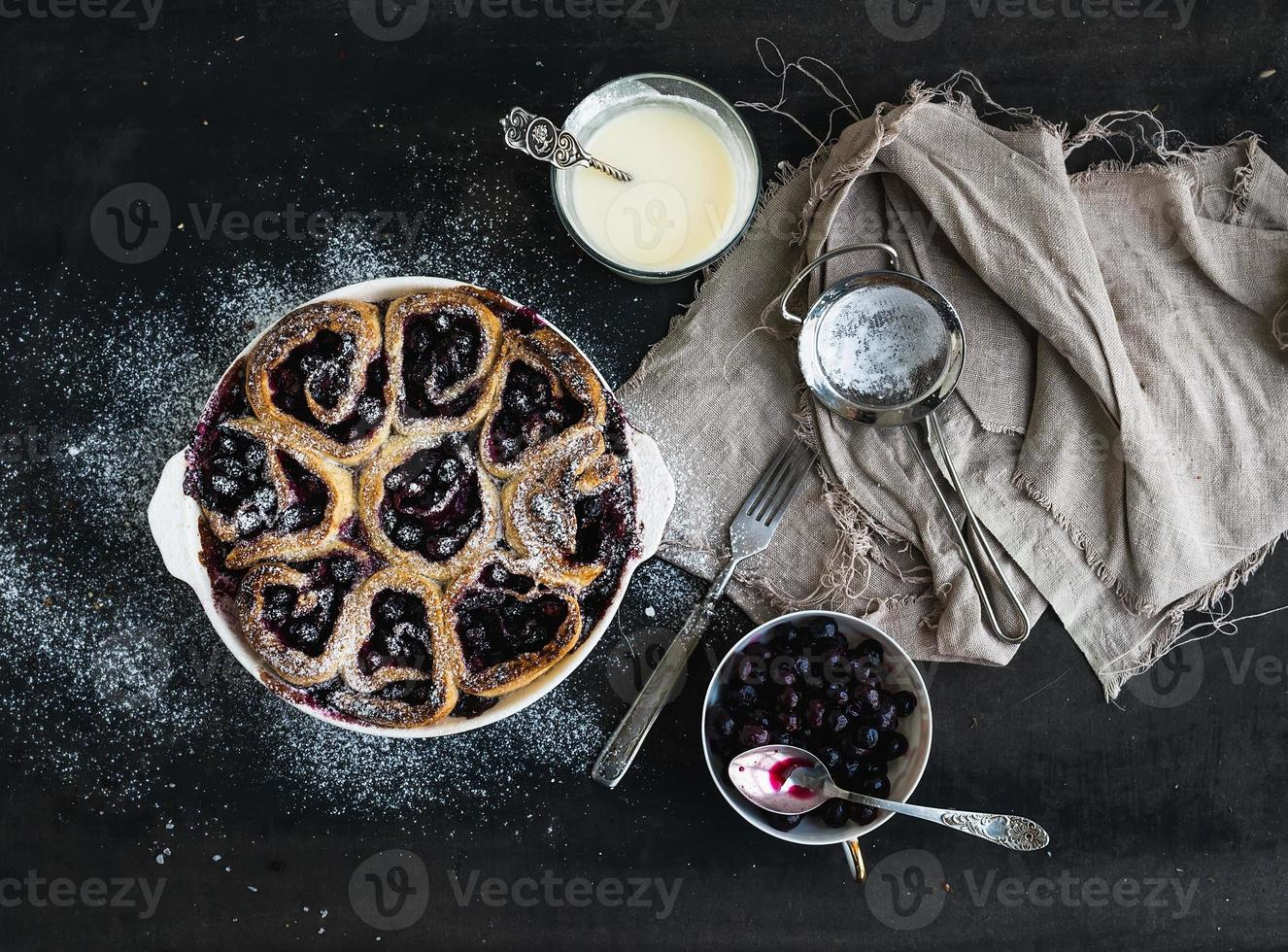 Blueberry buns with fresh mint and creamy sauce photo