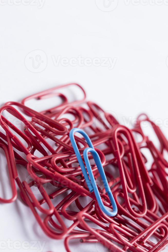 paperclips on a white surface photo