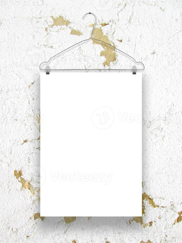 One paper sheet with a wire clothes hanger photo