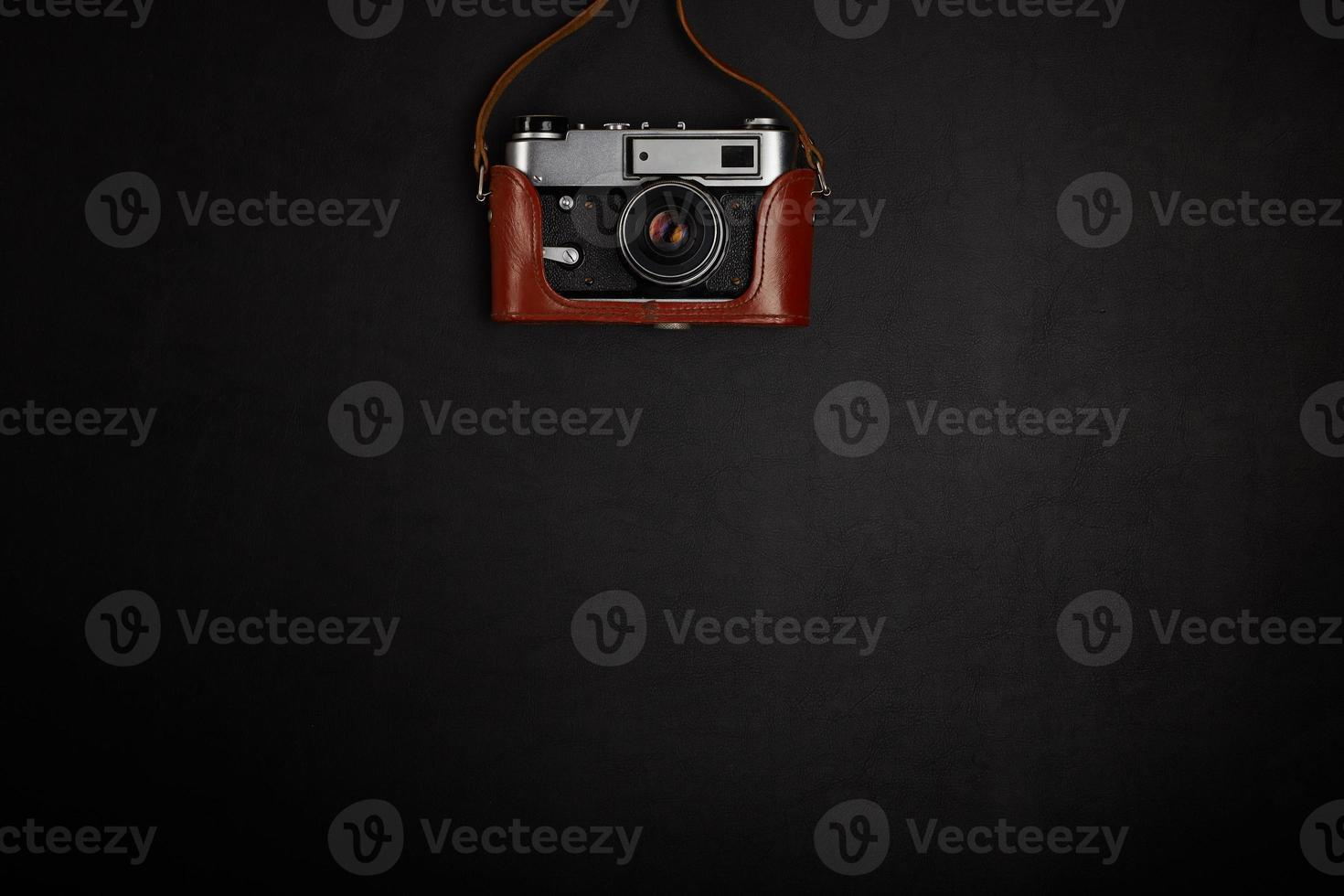 Vintage film camera on office table. Top view photo