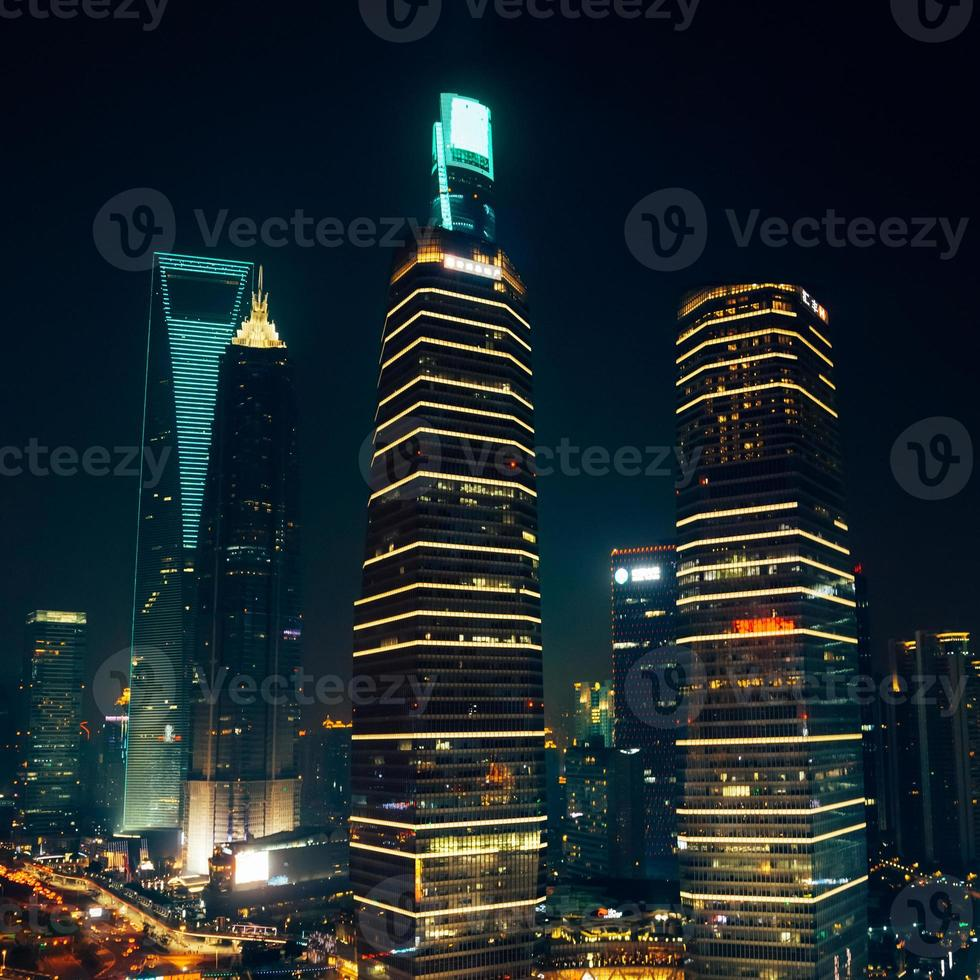 Skyscrapers and office buildings at night in Shanghai photo