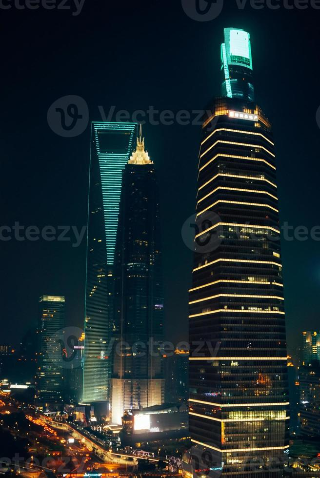 Skyscraper Office Buildings in Shanghai Pudong at Night photo