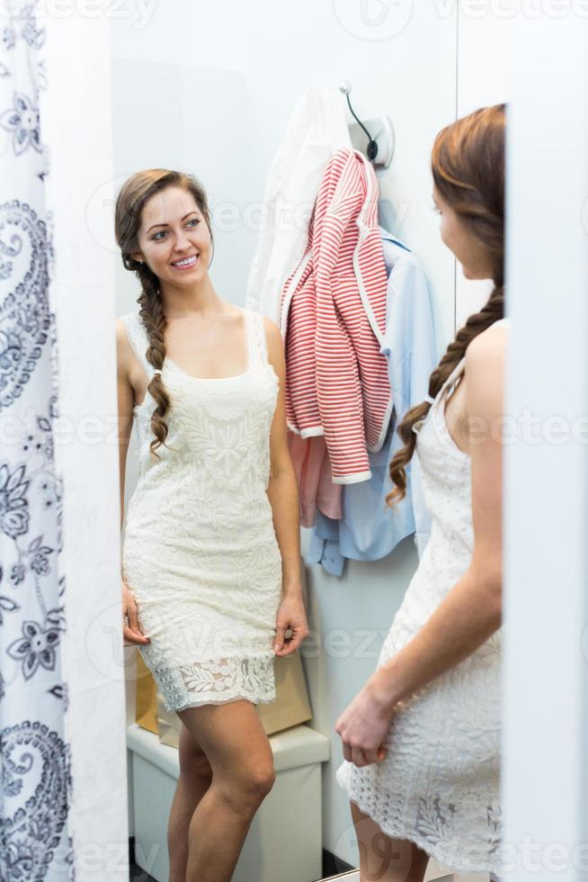 Girl at boutique changing cubicle photo