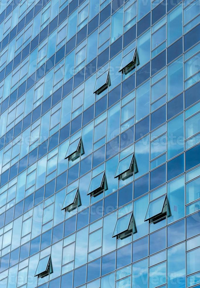 Architectural detail of a modern glass skyscraper building photo