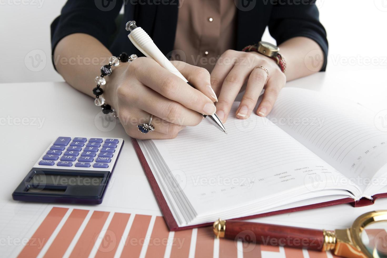 woman calculates future plans photo