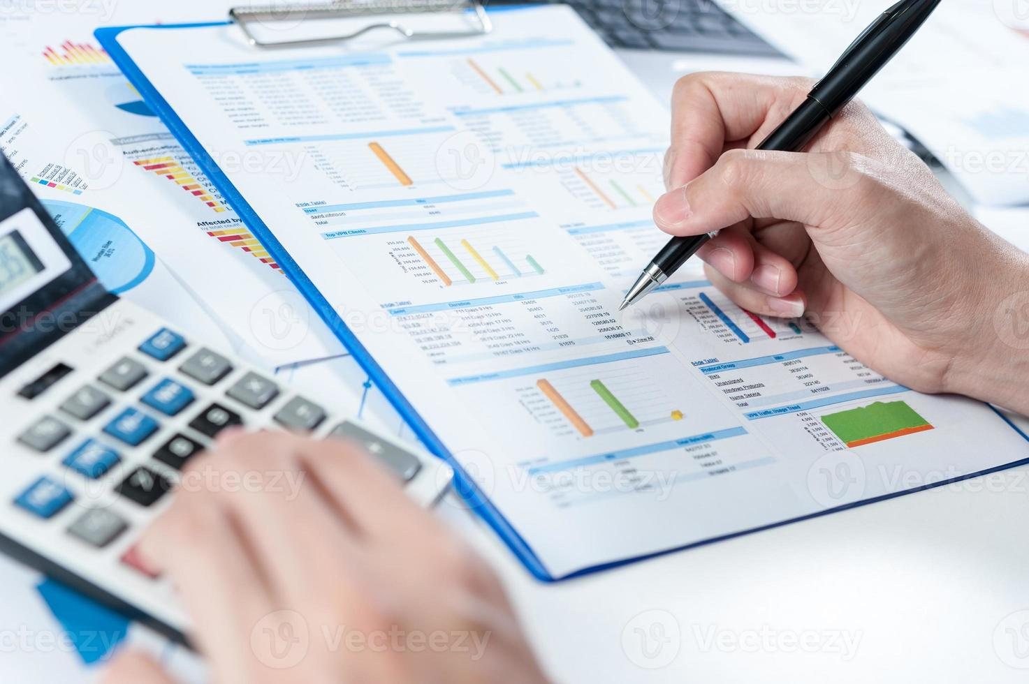 Businessman analyzing report, business performance concept photo
