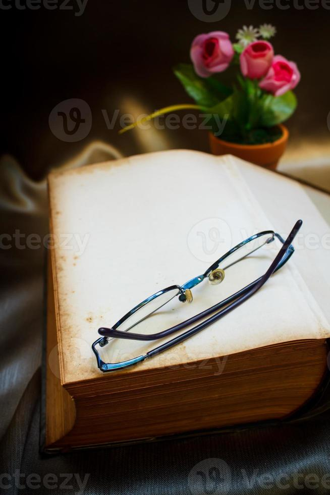 Old book and glasses. photo