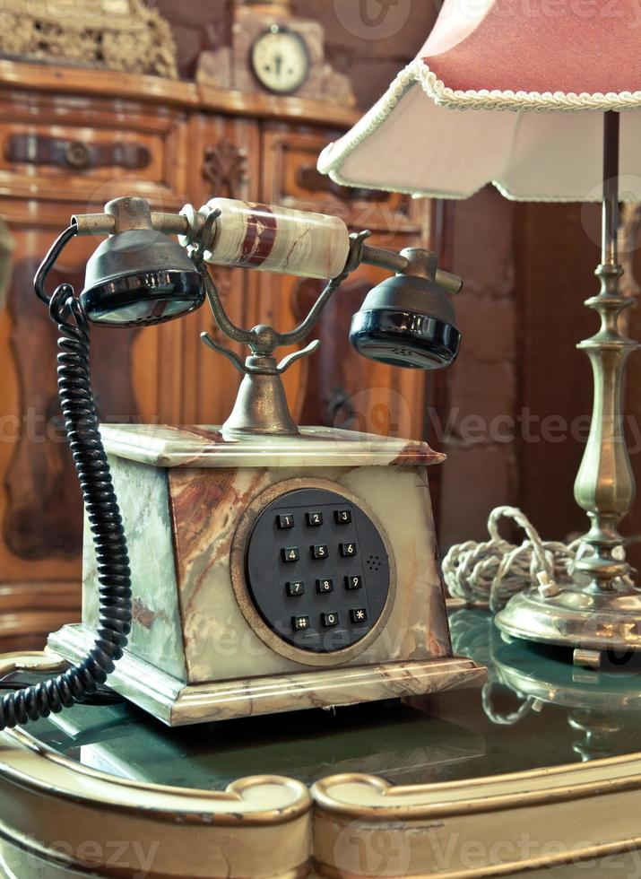 vintage telephone on the table photo