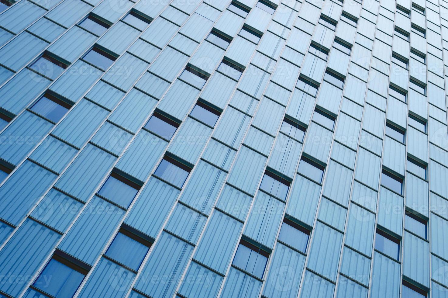 Abstract view to steel blue background of glass facade photo