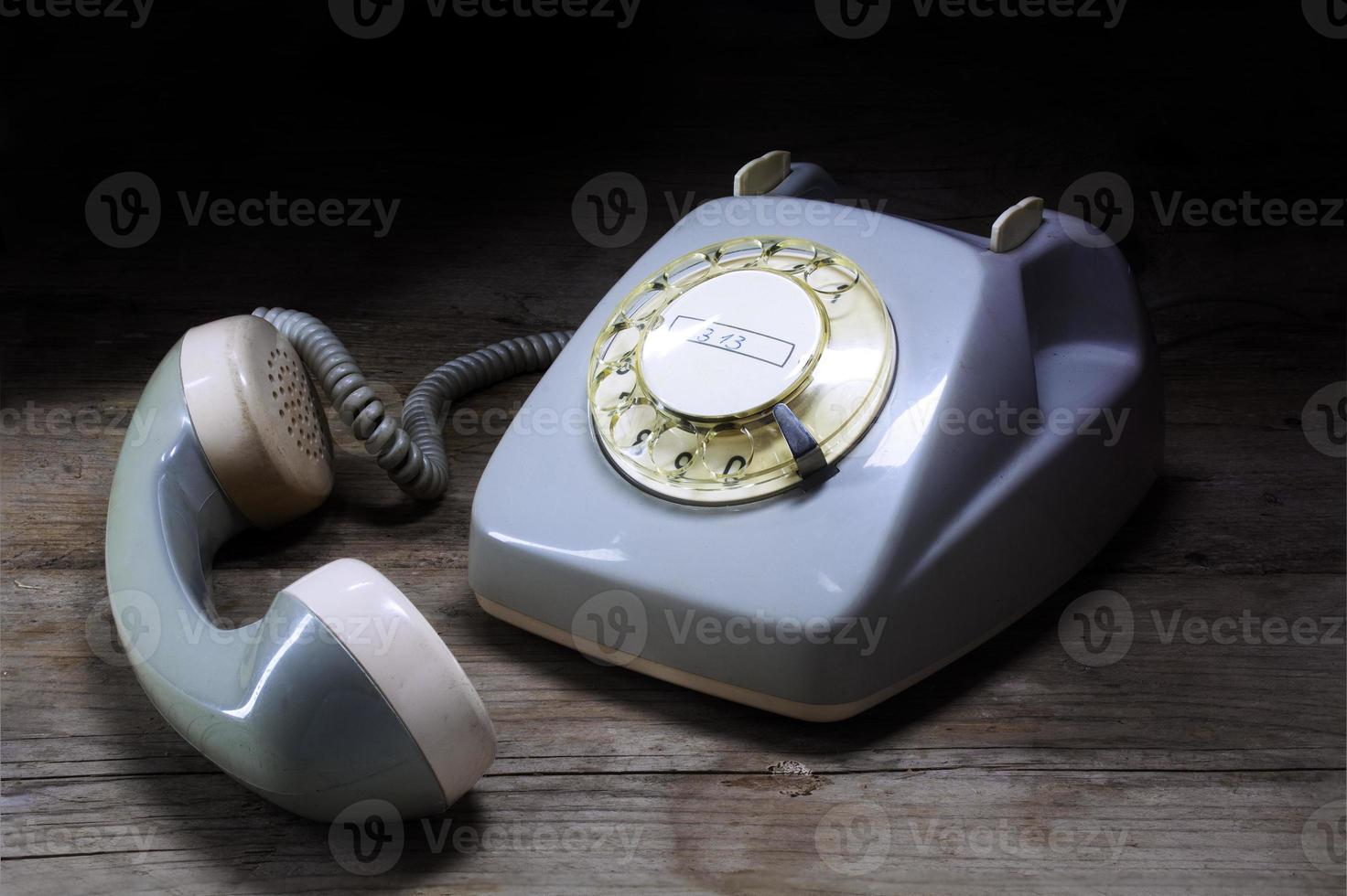 retro rotary telephone with rotary dial and removed receiver on photo