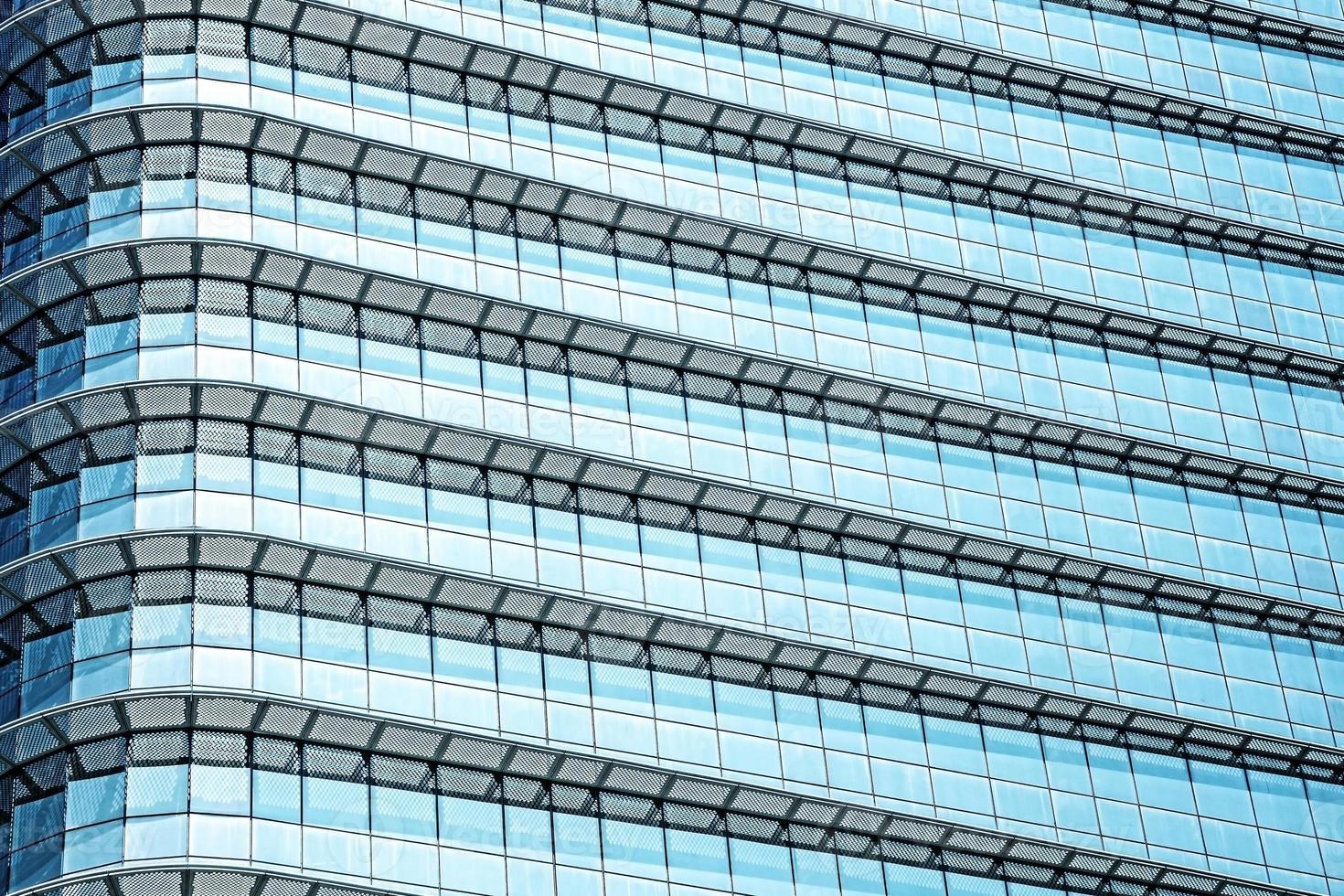 Fondo abstracto azul, vidrio y acero del edificio moderno. foto