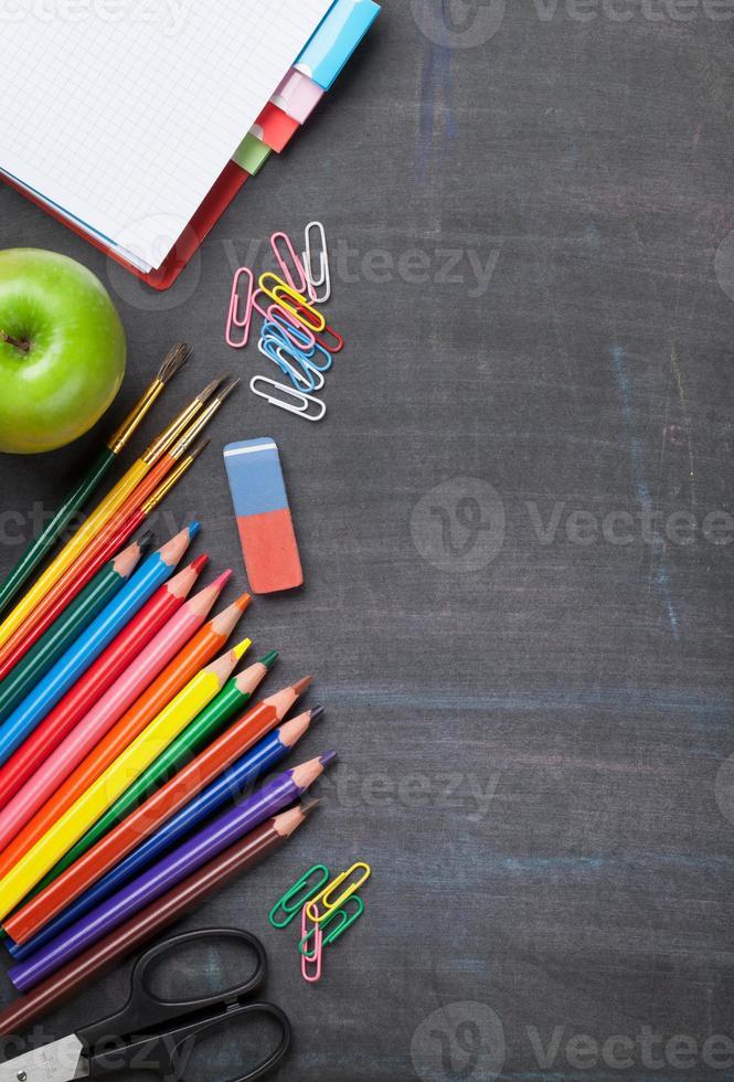School supplies on blackboard background photo