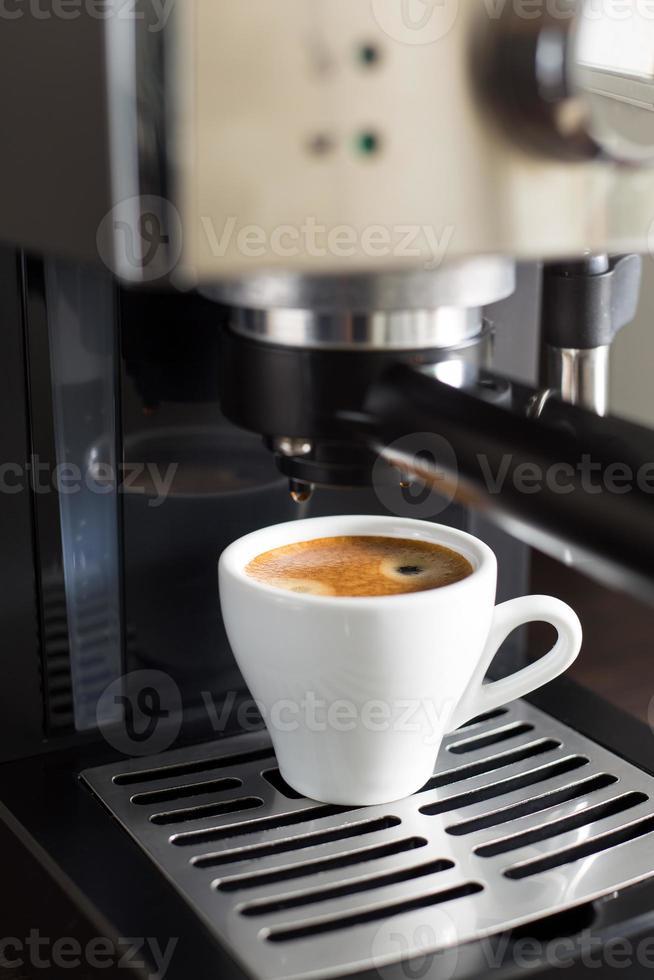 Domestic coffee machine makes espresso photo