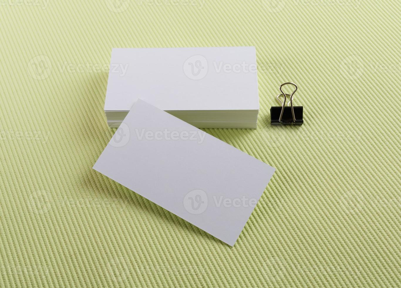 Business cards on green photo