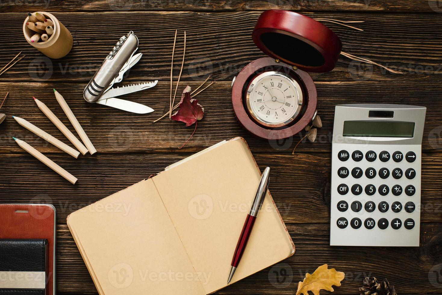 Business accessories on wooden table photo