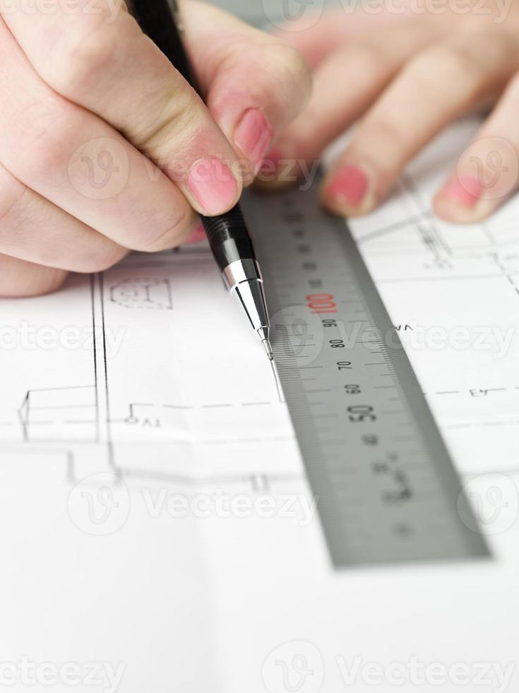 Female architect working on a bluprint photo