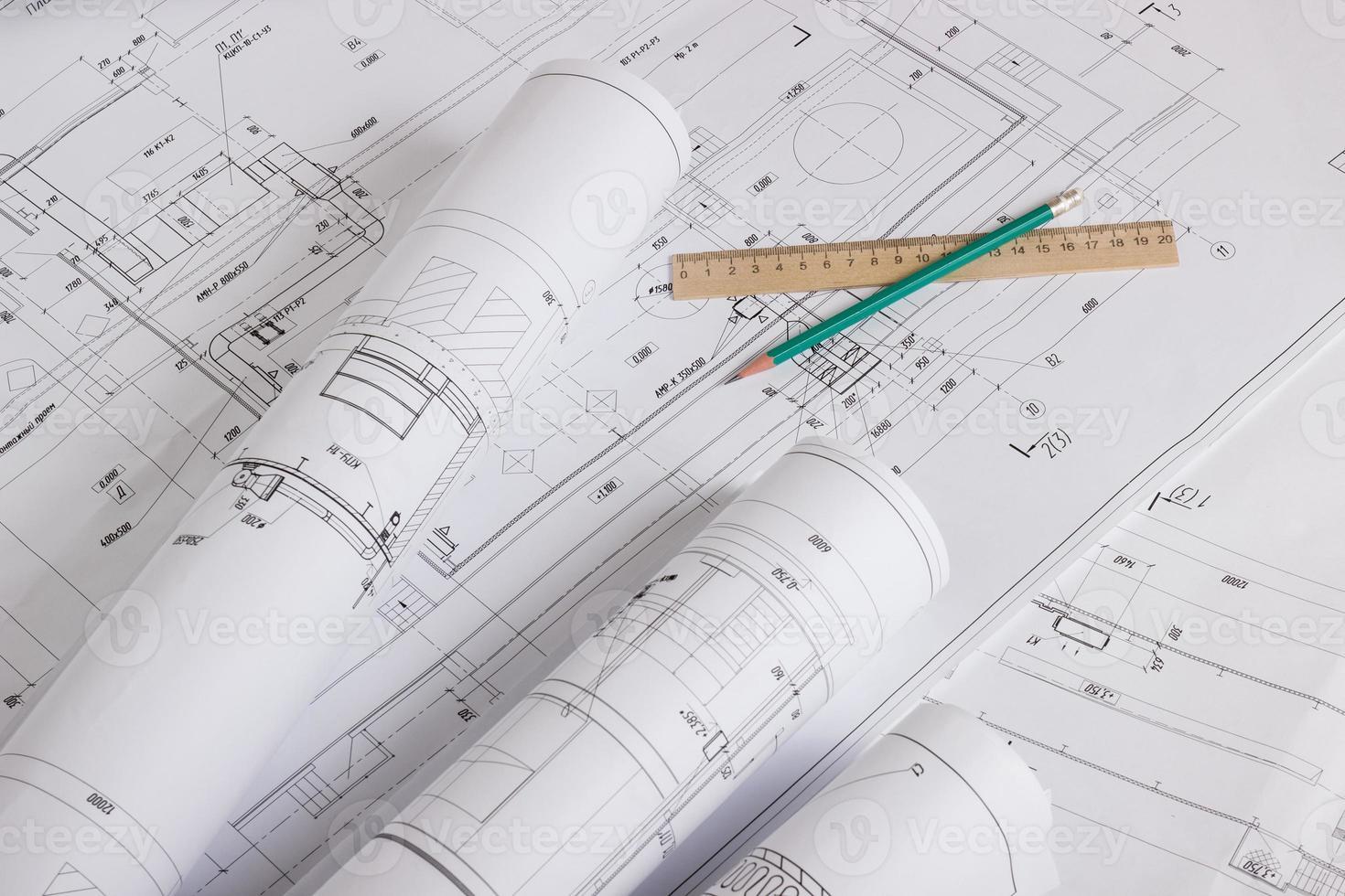 Architectural blueprints and blueprint rolls photo