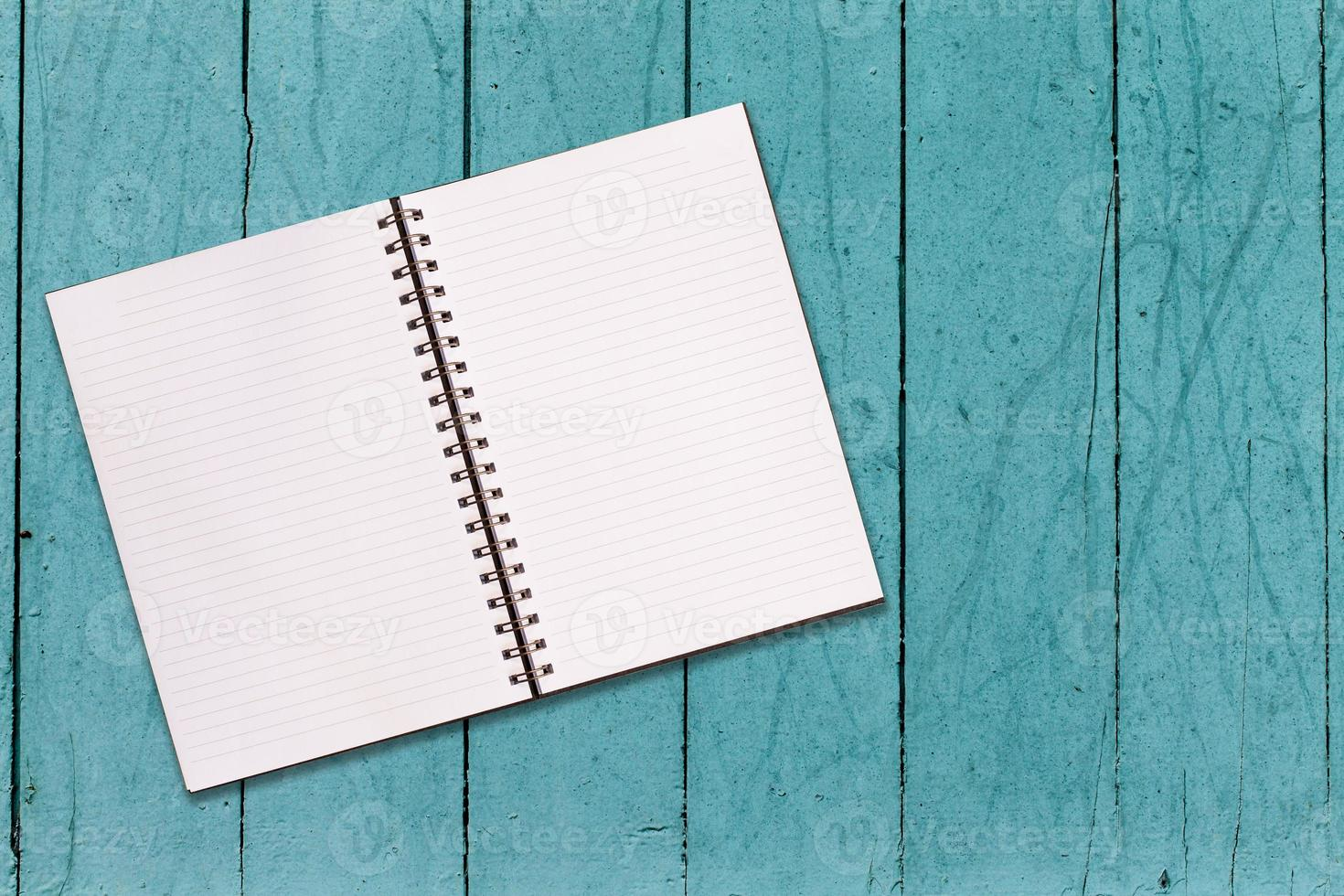 Note Book On Vintage Shabby Wood Background Wall Texture. photo