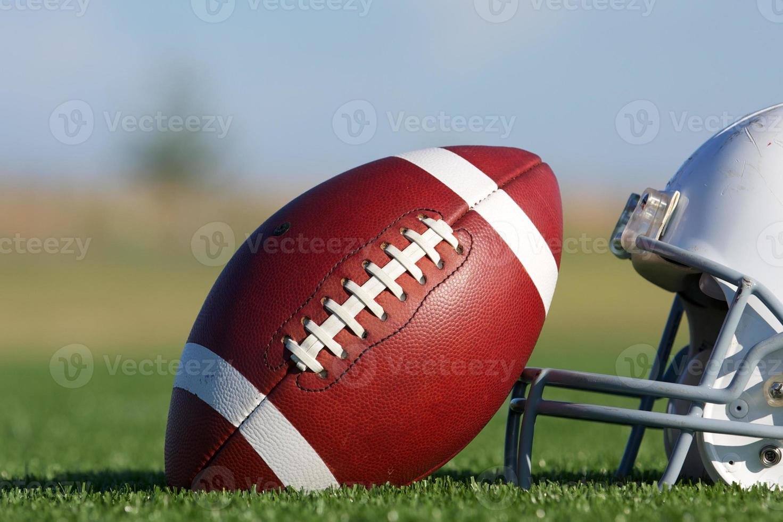 Football and Helmet on the Field photo