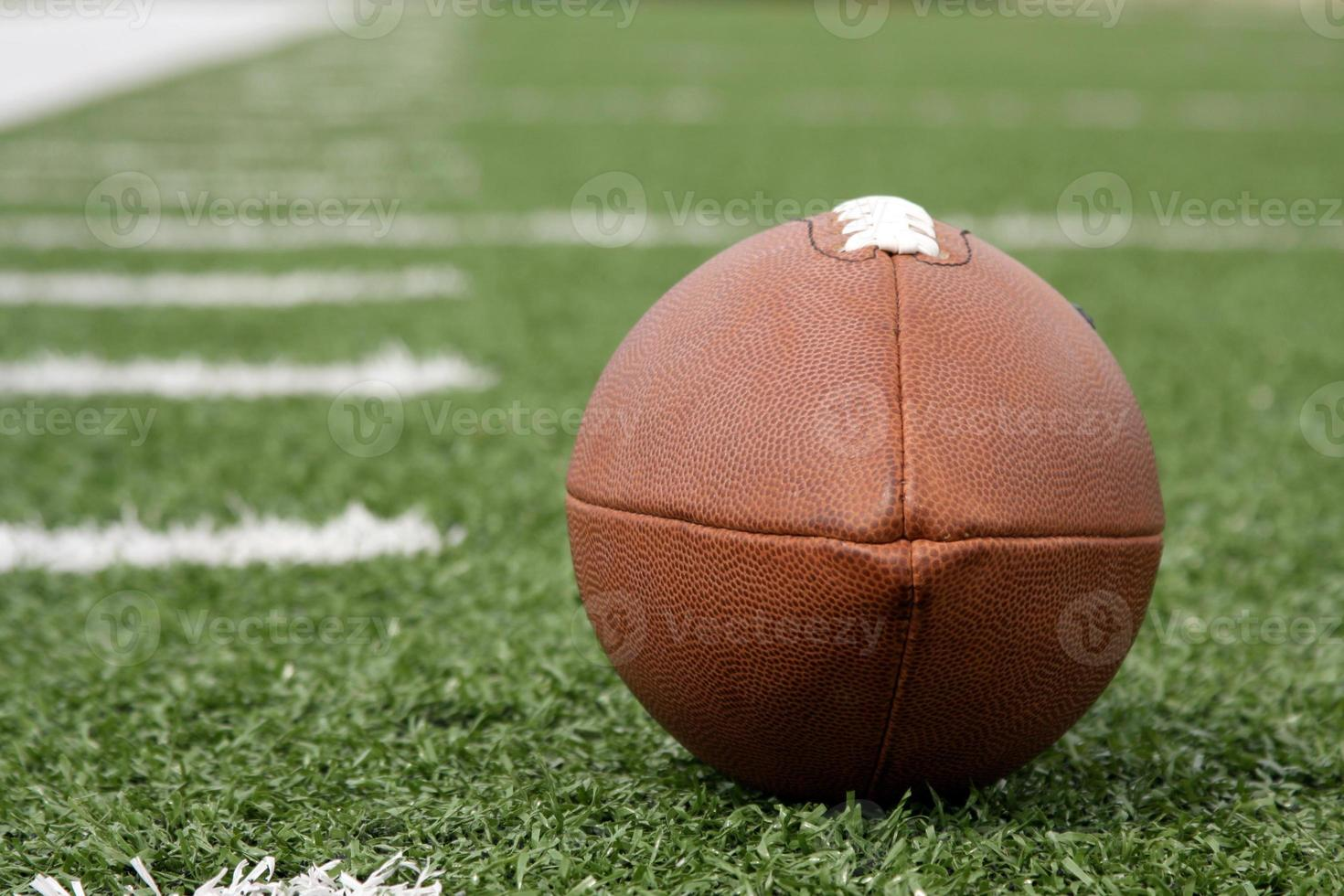 American Football near the yard lines on a field photo