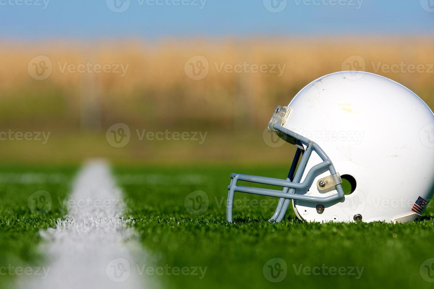 American Football Helmet on Field photo
