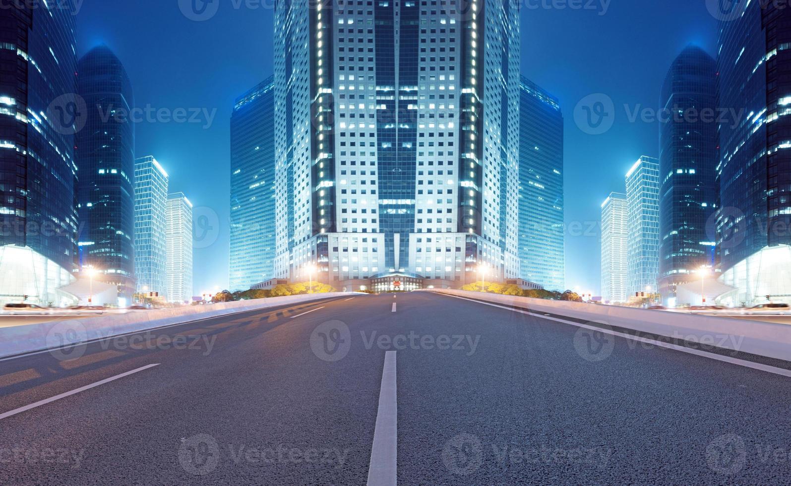 Asphalt road and modern city photo