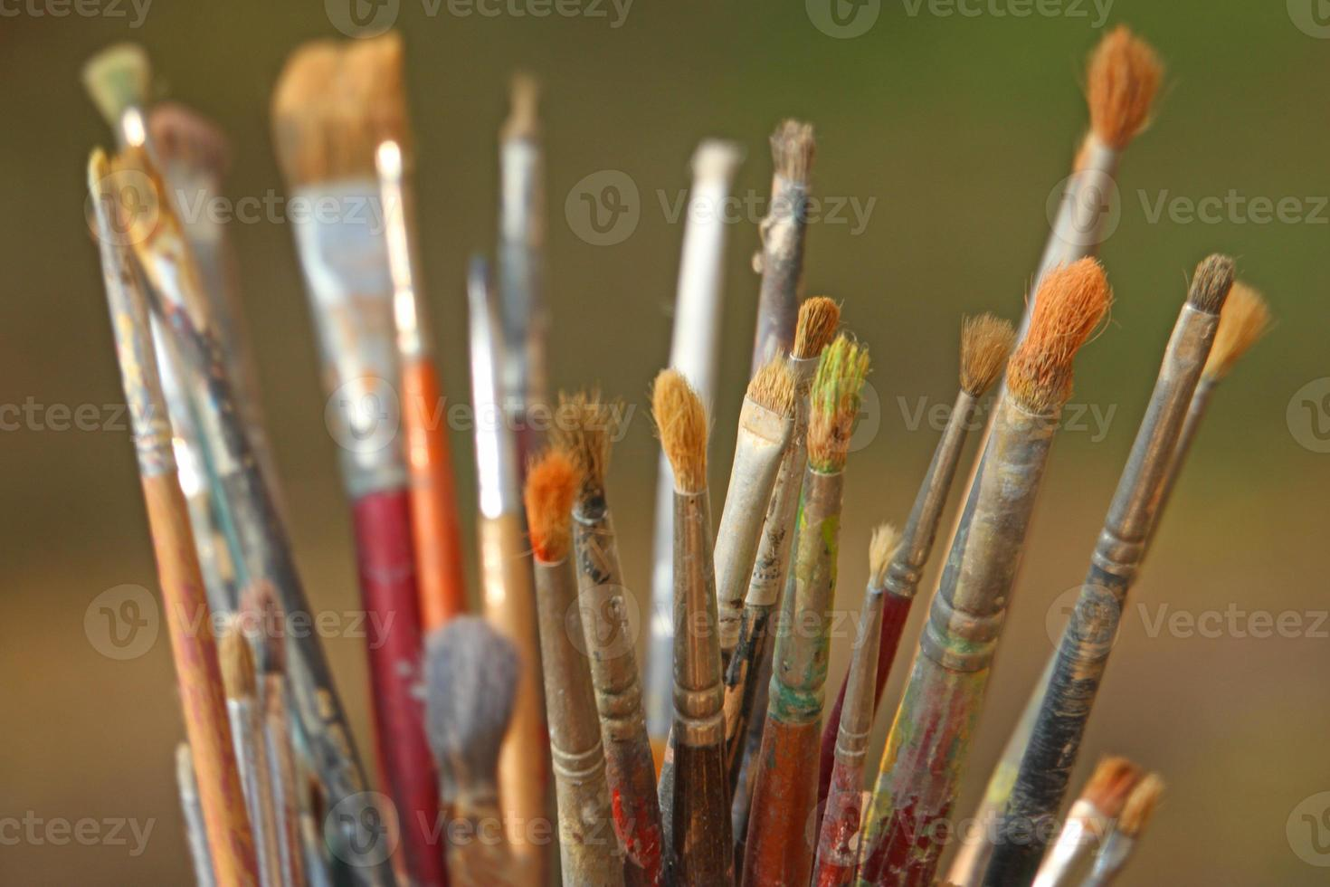 set of brushes used by a painter in painting workshop photo