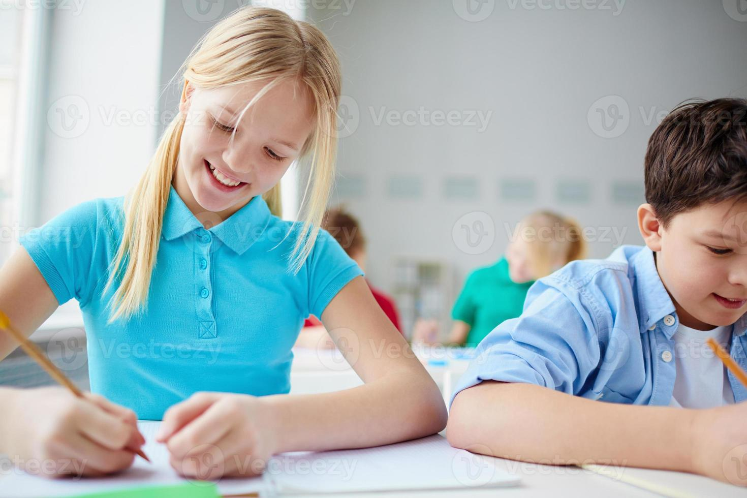 Cute schoolkids at lesson photo