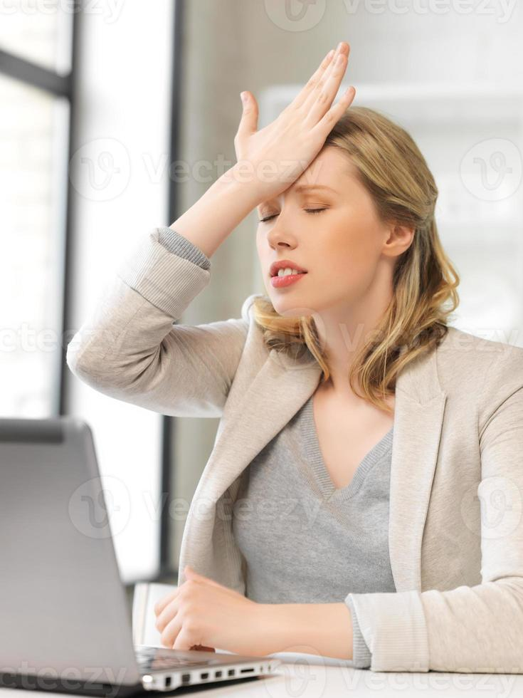 businesswoman holding her head with hand photo