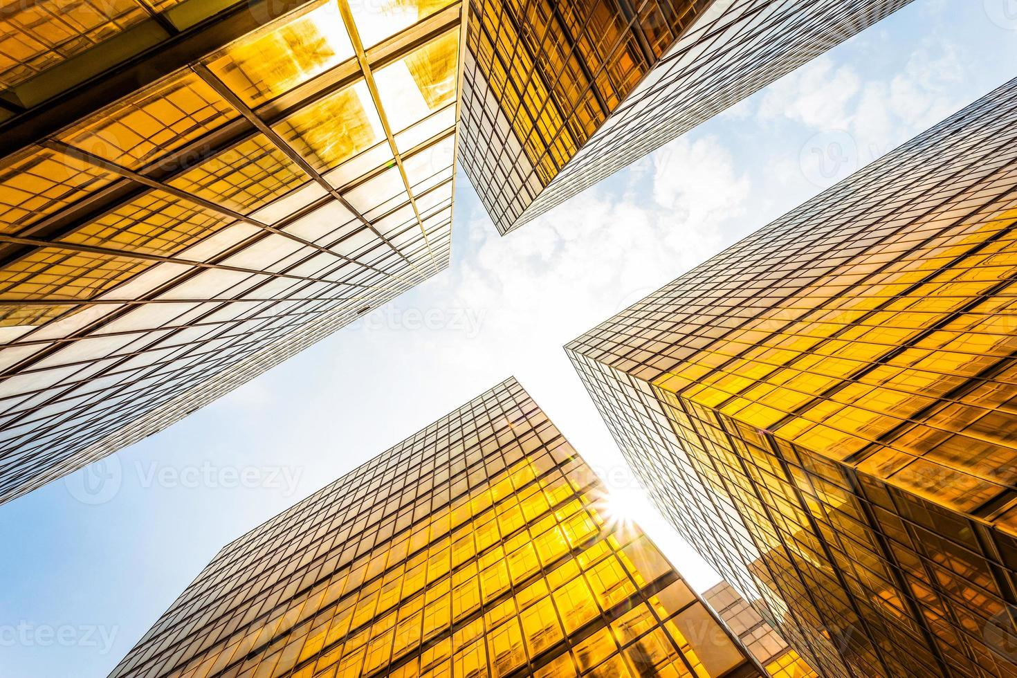 low angle view of modern skyscraper exterior and sky photo