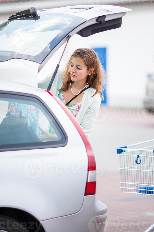 Beautiful young woman going shopping for groceries photo