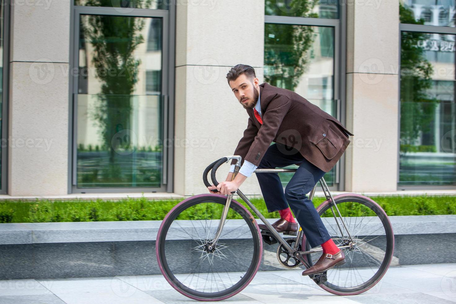Handsome businessman and his bicycle photo
